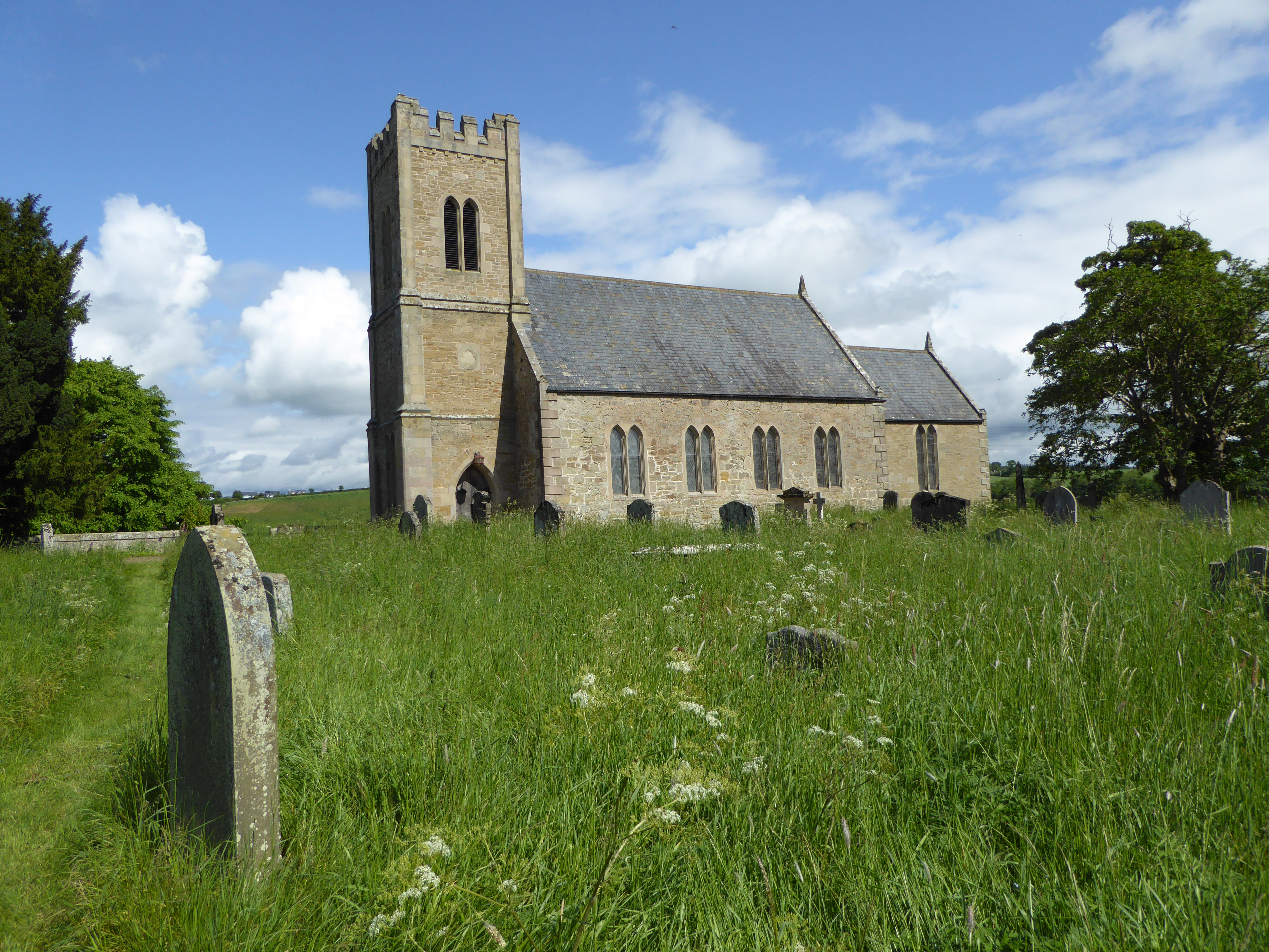 The Church of St Cuthbert, in the hamlet of Carham, is in a beautiful setting on the south bank of the River Tweed